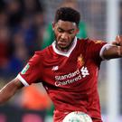 Defender Joe Gomez insists Liverpool have to play their normal game against Roma next week.