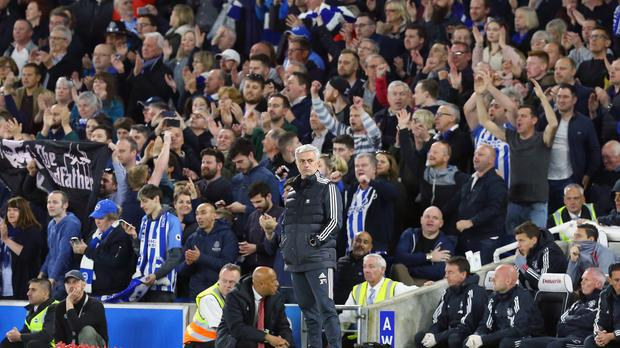 Jose Mourinho appears dejected as Brighton secured survival