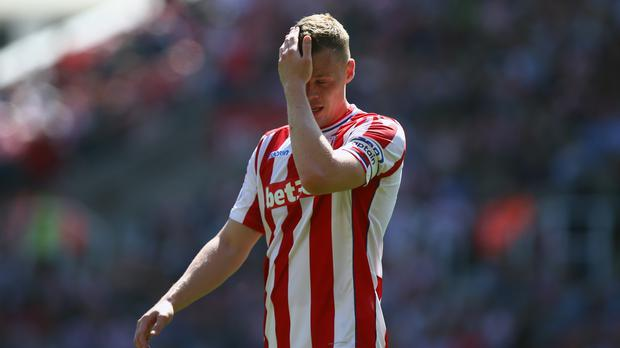 Stoke captain Ryan Shawcross shows his dejection