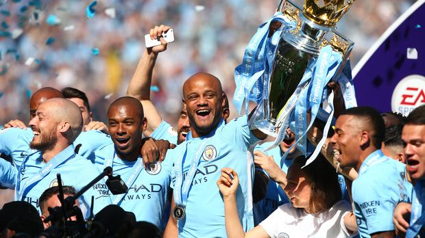 Vincent Kompany celebrates with the trophy (Dave Thompson/EMPICS)