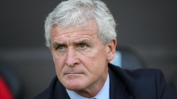 Southampton manager Mark Hughes says the Saints are not safe from the threat of relegation from the Premier League despite winning at Swansea (Nick Potts/PA)