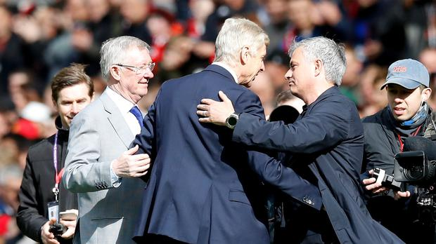 Manchester United manager Jose Mourinho (right) says everyone a the club remains positive over the recovery of Sir Alex Ferguson (left). (Martin Rickett/PA Images)