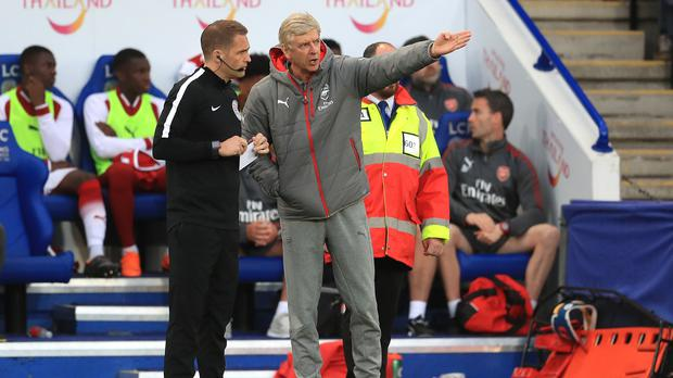 Arsenal manager Arsene Wenger appeals to fourth official Craig Pawson during defeat at Leicester