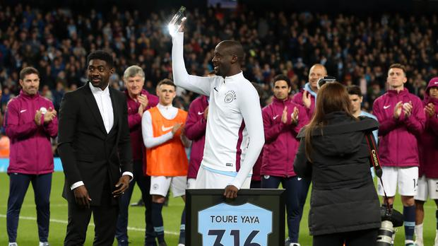 Kolo Toure presents Yaya Toure with a plaque