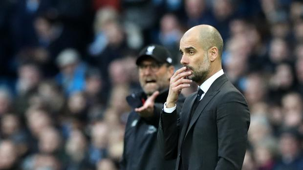 Pep Guardiola (right) expects a strong challenge from Jurgen Klopp (left) next season