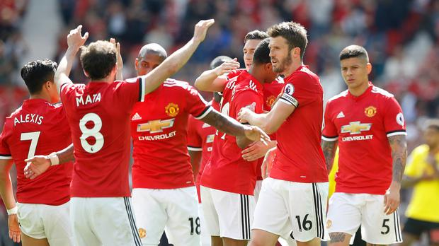 Michael Carrick (centre) had a hand in United's winner