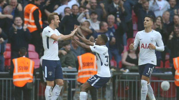 Harry Kane scored twice as Tottenham bowed out at Wembley with a win