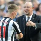 Rafael Benitez (right) embraces Matt Ritchie as he leaves the field