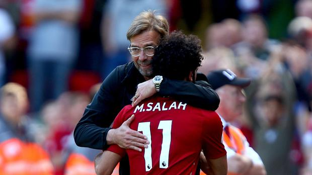 Jurgen Klopp, left, hugs Mohamed Salah