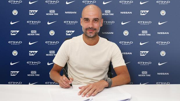 Pep Guardiola Signs New Contract Handout Photos