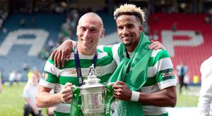 Celtic's Scott Brown (left) and Scott Sinclair celebrate with the Scottish Cup. Photo: PA