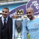 Manchester City manager Pep Guardiola, right, celebrates the Premier League title with chairman Khaldoon Al Mubarak