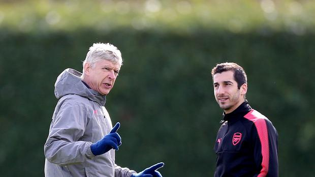 Former Arsenal manager Arsene Wenger (left) brought Henrikh Mkhitaryan (right) to the club during January. (Nigel French/PA Images)
