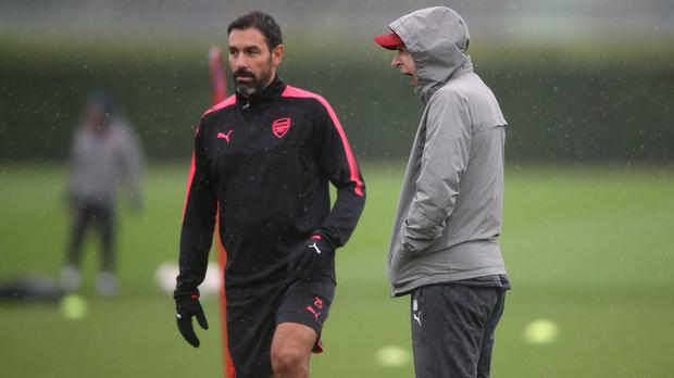 Robert Pires, left, has maintained close ties with Arsenal (John Walton/PA)