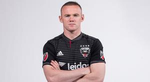 Wayne Rooney poses in his new DC United kit