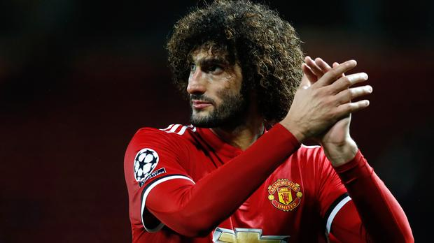 Midfielder Marouane Fellaini has signed a new two-year contract with Manchester United (Martin Rickett/PA)