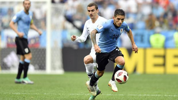Uruguay midfielder Lucas Torreira (right) is set for a move to Arsenal. (Martin Meissner/AP Photo)
