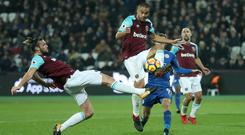 West Ham United's Andy Carroll (left) and Winston Reid go for the ball during the Premier League match at the London Stadium.