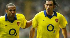 Robert Pires (right) believes former Arsenal colleague Thierry Henry will be a successful manager. (Jon Super/PA)