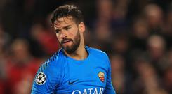 Alisson could be heading to Anfield (Peter Byrne/PA)