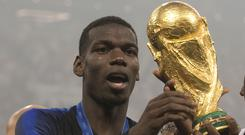 Paul Pogba got to grips with the World Cup trophy (Owen Humphreys/PA)