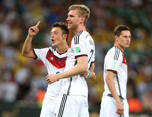 Mesut Ozil, pictured left, became a world champion in 2014 (Mike Egerton/PA)