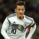 Mesut Ozil has retired from international football (Mike Egerton/PA)