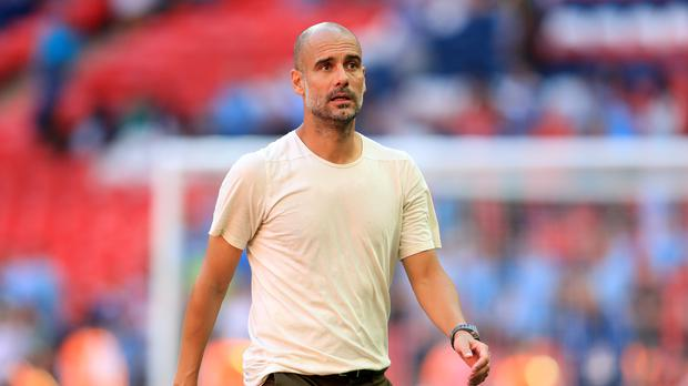 Manchester City manager Pep Guardiola wants an extra midfielder (Mike Egerton/PA)