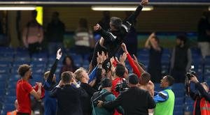 Huddersfield's players and manager David Wagner celebrate Premier League survival after drawing at Chelsea in May (John Walton/PA)
