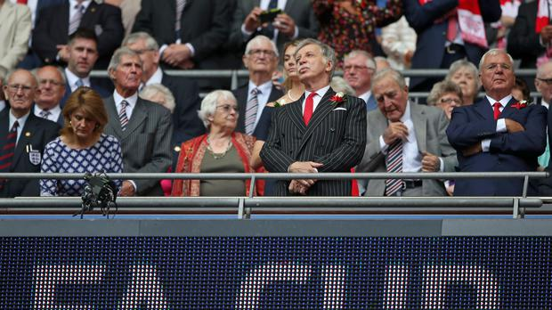 Stan Kroenke (centre) is set to take complete control of Arsenal (Nick Potts/PA)