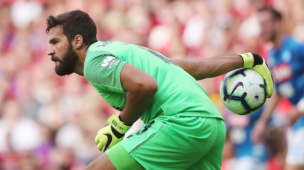 Alisson Becker joined Liverpool from Roma for a world record fee for a goalkeeper last month (Niall Carson/PA Images)