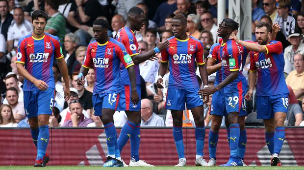 Wilfried Zaha, centre, celebrates his clinching goal with team-mates (Yui Mok/PA)
