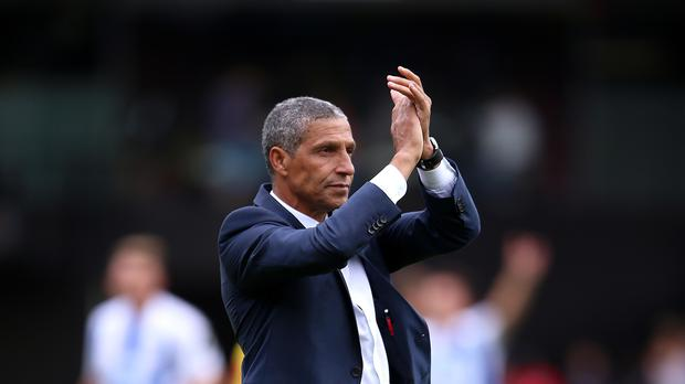 Brighton and Hove Albion manager Chris Hughton applauds the fans after the Premier League match at Vicarage Road, Watford.