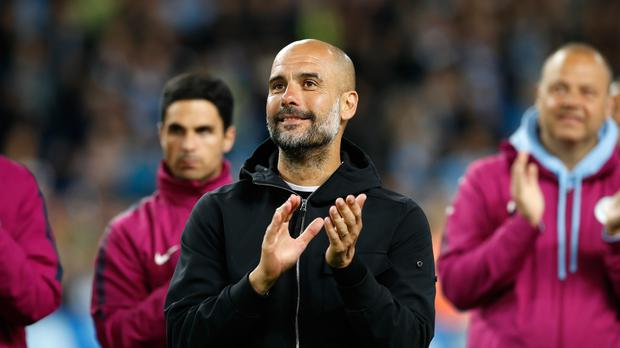Pep Guardiola expects a response from Manchester City's rivals this season (Martin Rickett/PA)