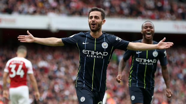 Manchester City's Bernardo Silva celebrates scoring his side's second goal of the game during the Premier League match at the Emirates Stadium, London.