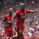 Liverpool's Sadio Mane celebrates scoring his side's third goal against West Ham (David Davies/PA)