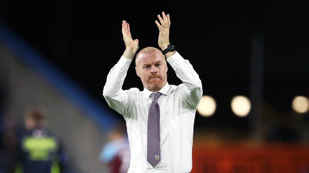 Burnley manager Sean Dyche applauds the fans after extra-time at Turf Moor (Nick Potts/PA)