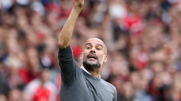 Manchester City boss Pep Guardiola is wary of the threat of Huddersfield (Nick Potts/PA)