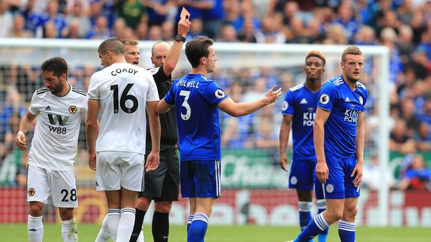 Jamie Vardy, right, is sent off by referee Mike Dean (Mike Egerton/PA)