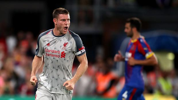 Liverpool's James Milner celebrates scoring his side's first goal of the game from the penalty spot during the Premier League match at Selhurst Park, London.