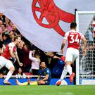 Nacho Monreal equalised for Arsenal before Issa Diop's own goal completed the comeback against West Ham. (Victoria Jones/PA)
