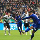 Chelsea's Eden Hazard scores his side's first goal of the game from the penalty spot during the Premier League match at St James' Park, Newcastle.