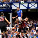 Dominic Calvert-Lewin, centre, heads at goal for Everton (Peter Byrne/PA)