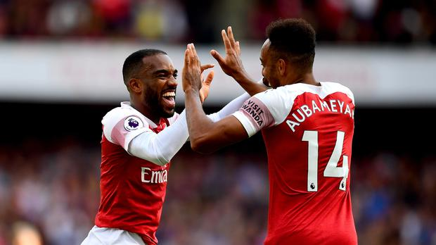 Arsenal's Alexandre Lacazette (left) and Arsenal's Pierre-Emerick Aubameyang (right) celebrate after West Ham United's Issa Diop scores an own-goal for their side's second goal during the Premier League match at the Emirates Stadium, London.