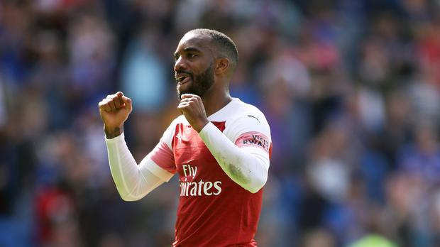 Arsenal's Alexandre Lacazette celebrates victory after during the Premier League match at the Cardiff City Stadium.