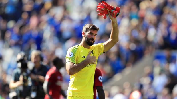 Liverpool goalkeeper Alisson acknowledges fans after the win over Leicester (Mike Egerton/PA)