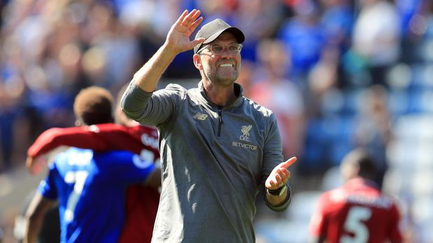 Can Jurgen Klopp's Liverpool keep up their perfect start to the new Premier League season? (Mike Egerton/PA)