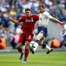 Liverpool's Roberto Firmino and Jan Vertonghen of Tottenham Hotspur battle for the ball during the Premier League match at Wembley Stadium yesterday. Photo: Julian Finney