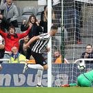 Ciaran Clark (centre) scores Newcastle's goal against Arsenal (Owen Humphreys/PA)