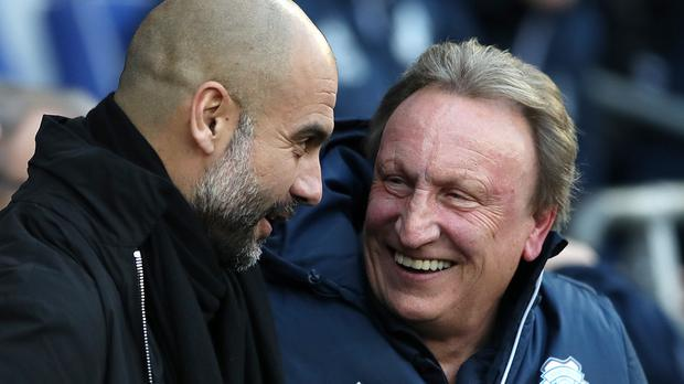 Pep Guardiola and Neil Warnock face each other this weekend (Nick Potts/PA)